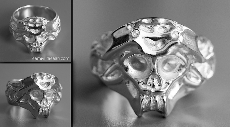 Hopeinen sormus pääkallolla. Korun suunnittelussa on käytetty 3D-mallinnusta sekä cnc-jyrsintä, jonka avulla on jyrsitty sormuksesta valumalli. Sami Viitasaari 2014.