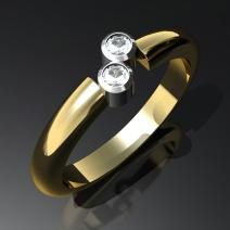 Kultasormus kahdella timantilla.